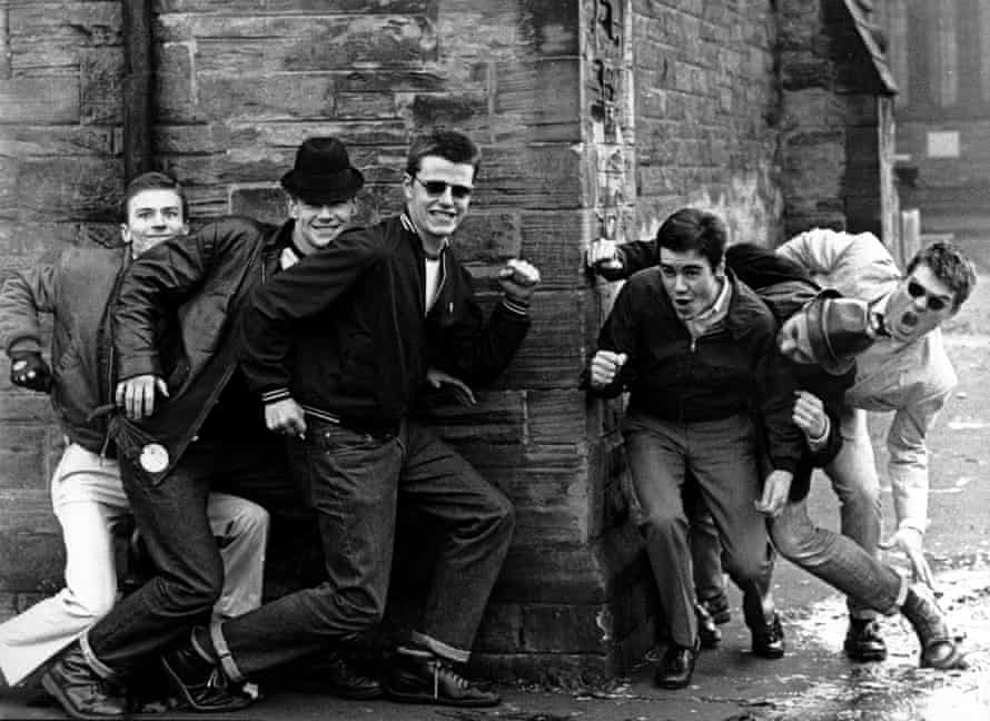 Madness including Chas Smash (second from left) and Suggs (third from left).