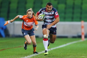 Assistant referee Amy Perrett follows Jonah Placid of the Rebels during the round 15 Super Rugby match between the Rebels and the Stormers at AAMI Park in Melbourne, Australia