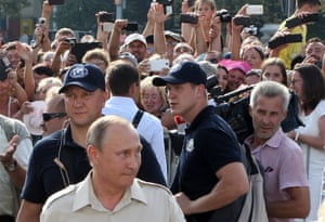 Devoted crowds welcome the Russian leader in Sevastopol before he heads out on to the water. Putin enjoys a celebrity status among his followers, unmatched by that of any of his western peers