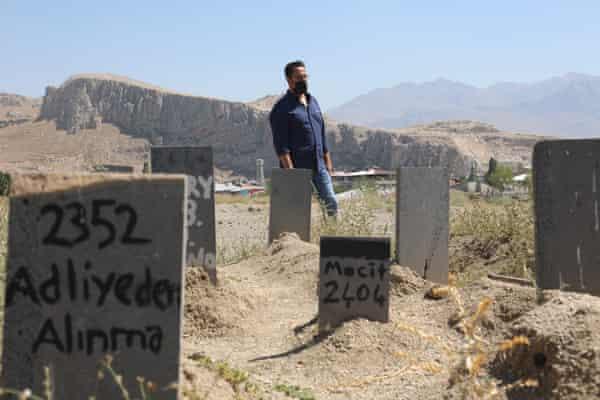 Lawyer Mahmut Kaçan among the graves of nameless refugees, in Van, Turkey.