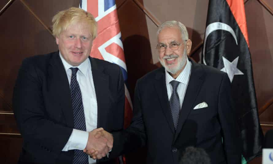 Boris Johnson, the British foreign secretary, shakes hands with his Libyan counterpart, Mohamed Taha Siala, in Tripoli.