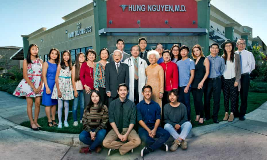 Voyage to a new life: Dr Hung Nguyen (above, centre), one of the 'boat people' rescued by the MV Wellpark, with his family outside his medical centre in Orange County, California.