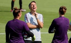 England's manager, Phil Neville, enjoys a joke during training at Terrain d'Honneur stadium in Lyon.