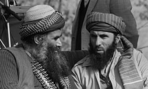 Gulbuddin Hekmatyar (right) confers with an Afghan guerrilla leader in Peshawar in January 1987.