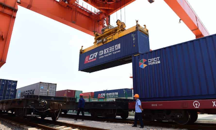 A container is lifted from the first freight train to run from Prague to Yiwu.