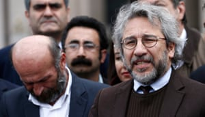 Can Dündar, right, arrives at court for his trial in Istanbul in 2016.