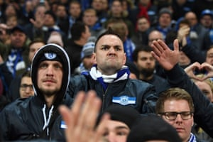 A Schalke fan reacts after their 7-0 defeat.