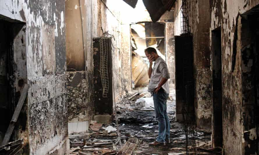 In October, an employee of Doctors Without Borders walks inside the charred remains of the organization's hospital after it was hit by a US airstrike in Kunduz, Afghanistan.