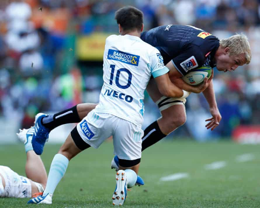 Otere Black of the Blues (left) tackles Pieter-Steph du Toit of the Stormers during the Super Rugby match between the Stormers of South Africa and the Blues of New Zealand at Newlands Stadium in Cape Town, South Africa, 29 February 2020.