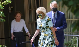 Former U.S. first lady Rosalynn Carter watches U.S. President Joe Biden and first lady Jill Biden depart after she saw them to the front door of her house.