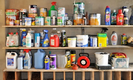 Interior of domestic garage storage shelves with varioius paint diy products.