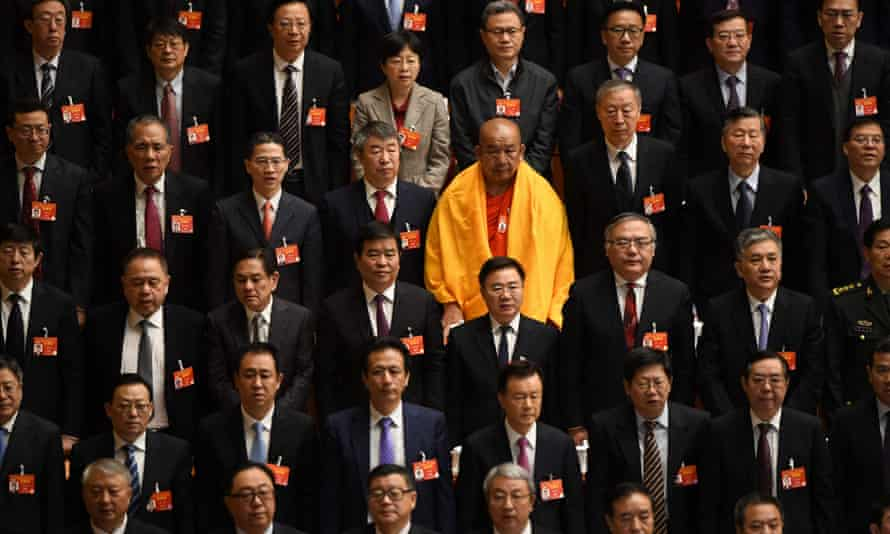 A lone woman is seen among delegates at the National People's Congress in Beijing