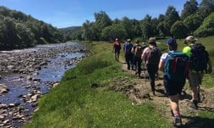 Group of walkers next to a stream on the Moray Walking & Outdoor Festival