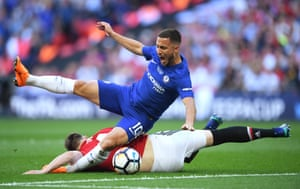 Eden Hazard is floored by Phil Jones.