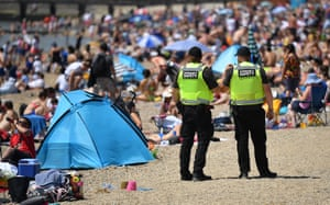 Southend-on-Sea, England Community safety officers, employed by the local council, patrol the beach to ensure physical distancing measures are adhered to and visitors do not drink alcohol