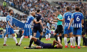 The Brighton captain Bruno, No 2, approaches Michael Oliver after the referee awarded Everton their late penalty.
