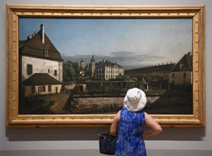 London, England A visitor inspects The Fortress of Konigstein: Courtyard with the Brunnenhaus by Bernardo Bellotto before an exhibition of his work at the National Gallery