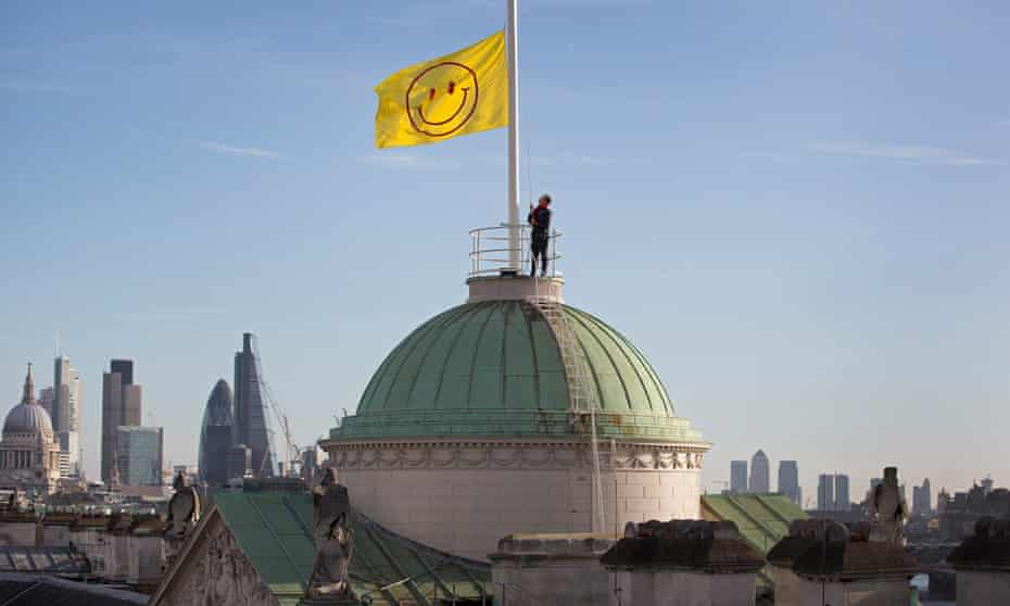 Smiling on London ... Jeremy Deller and Fraser Muggeridge's flag is raised above Somerset House to launch 'Utopia 2016