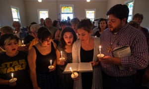 Community supporters sing a hymn during a vigil on Wednesday evening.