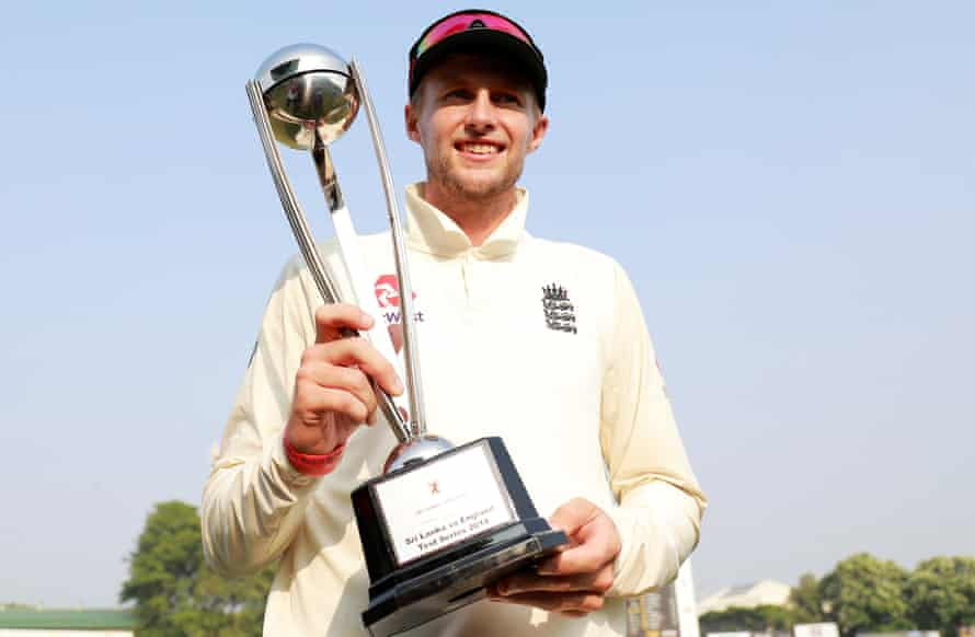 Joe Root shows off the trophy.