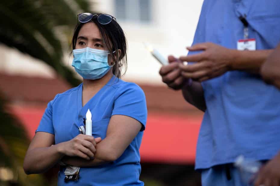Hospital staff hold a vigil for Celia Marcos, a health worker who died in Los Angeles in May. The absence of reliable federal data exacerbated critical problems such as shortages of PPE that left many workers exposed.