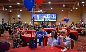 Trump supporters listen to Democratic Presidential candidate Joe Biden during a Republican watch party at the South Point Hotel & Casino in Las Vegas, Nevada, USA, 3 November 2020.