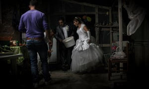 A Romanian wedding inside a warehouses on a farm in the Ragusa valley in Sicily