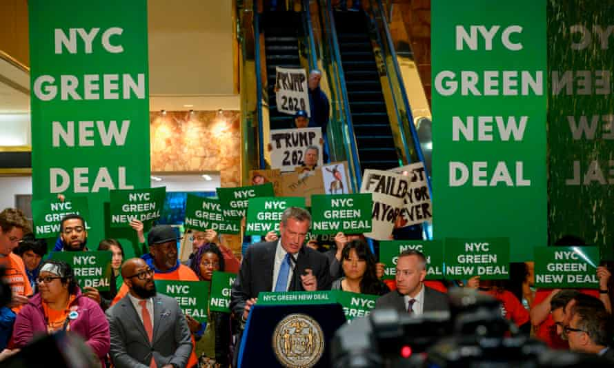 New York City's mayor, Bill de Blasio, speaks inside Trump Tower about the Green New Deal on 13 May.