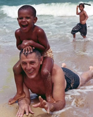 Barack Obama on the beach with his grandfather, Stanley Armour Dunham, in the 1960's.