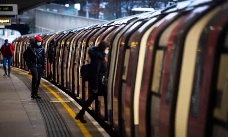Commuters getting on a Jubilee Line train during England's latest national lockdown.