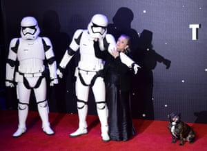 Carrie Fisher and a dog called Gary pose for the cameras with a couple of storm troopers