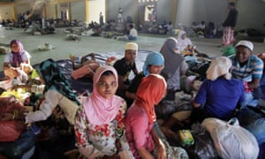 Rohingya refugees get some rest in a stadium in Aceh, Indonesia on Wednesday. The UN's refugee body said that between January and March this year, almost 25,000 Rohingya and Bangladeshis boarded smugglers' boats.