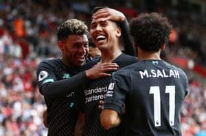 Roberto Firmino celebrates scoring Liverpool's second goal.