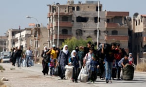 Civilians being evacuated from Darayya in 2016. Shia families from Iraq later moved into the abandoned neighbourhoods.