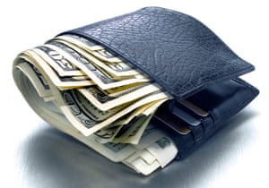 Fat wallet stuffed with dollars on a white background