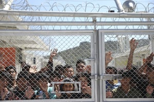 Migrants await the arrival Pope Francis at the Moria refugee camp
