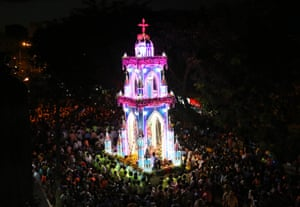 Bangalore, IndiaWorshippers crowd around a chariot carrying a statue of Virgin Mary outside St. Mary's Basilica, the oldest church in Bangalore, for the Feast of Nativity of the Virgin Mary