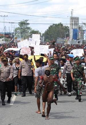 Demonstrators march during a protest in Timika, West Papua Province., Wednesday, Aug. 21, 2019.