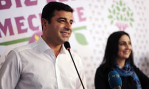 Selahattin Demirtas (L) and Figen Yukseldag (R), co-chairs of the pro-Kurdish Peoples' Democratic Party (HDP), hold a press conference in Istanbul.