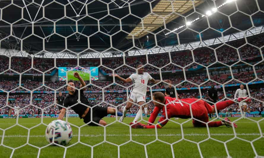 England's Raheem Sterling watches the ball hit the net to open the scoring against Germany at Wembley