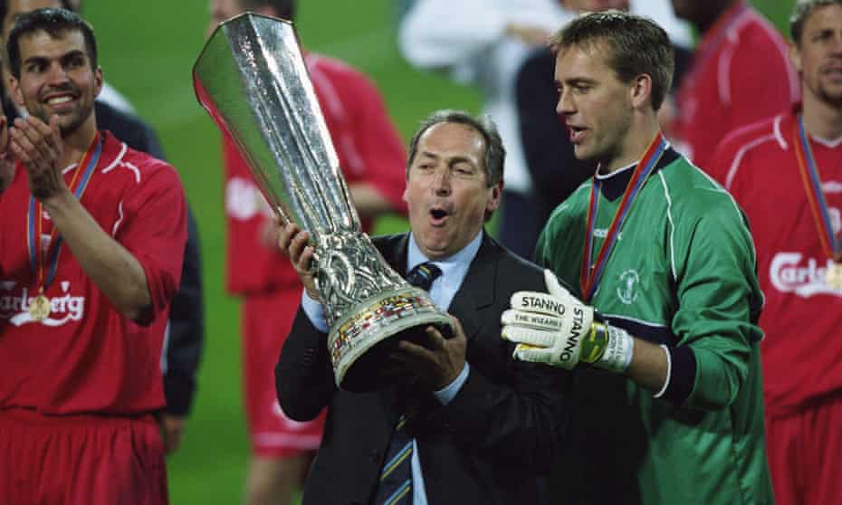 Gérard Houllier celebrates Liverpool's victory in the 2001 Uefa Cup final, which completed a treble of trophies for the club that season and was the Frenchman's crowning achievement as manager.