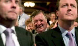 Clarke, seated behind Liam Fox and David Cameron at the 2005 Conservative party conference in Blackpool.