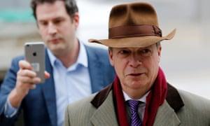 'The Brussels Howard Hughes.' Nigel Farage rocks up to meet Michel Barnier in look-at-me brown fedora.