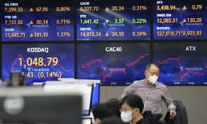 Screens showing foreign exchange rates at the foreign exchange dealing room of the KEB Hana Bank headquarters in Seoul, South Korea, as Asian stock markets fell today