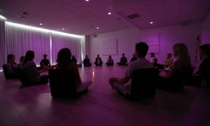 Participants meditate during a class at Unplug, a new meditation studio in Los Angeles.