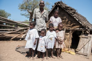 Lahie together with his wife, Njomasy, and their children, from left, Vorito 3, Lovasoa 2, Fanampesoa 3 and Rasoa 5, stand in front of their house in Satrie village.