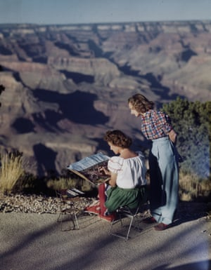Two woman admire a watercolor at the rim of the Grand Canyon.