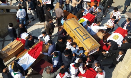 Coffins of the victims of a bomb explosion at a Coptic church in Cairo, 2016.