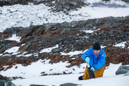 Thilo Maack takes snow samples on Greenwich Island in the Antarctic to test for environmental pollutants.