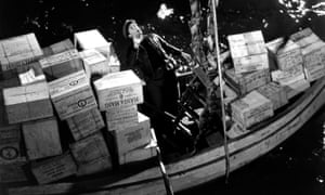 Still from Whisky Galore – man on boat with crates of whisky